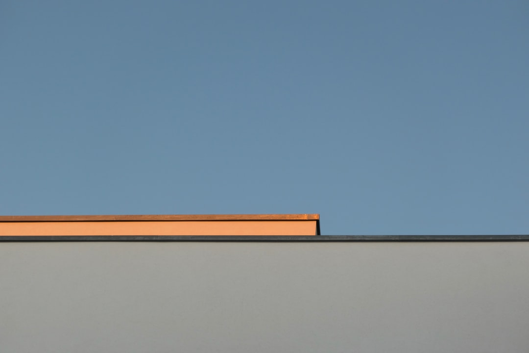 Blue Sky, Sunset Light and the Roof of A House - unsplash