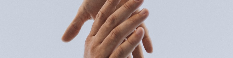 view of two persons hands
