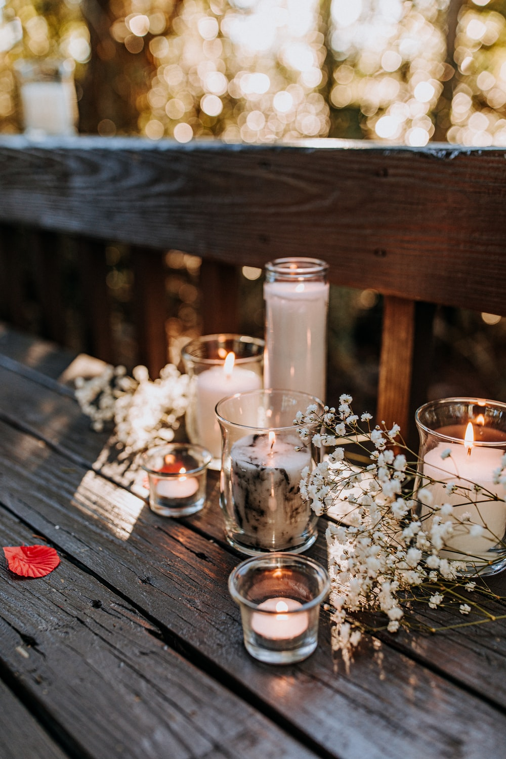 lit candles with white flower