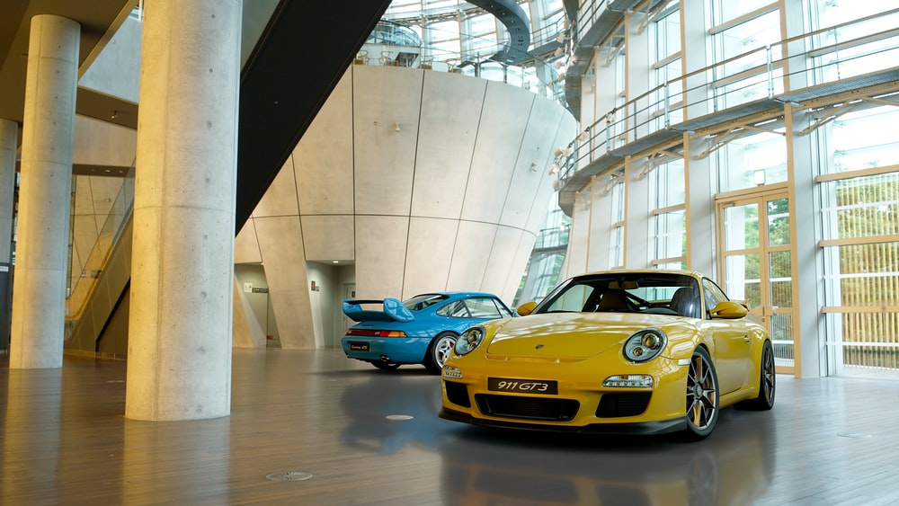 yellow and blue vehicles inside buildings