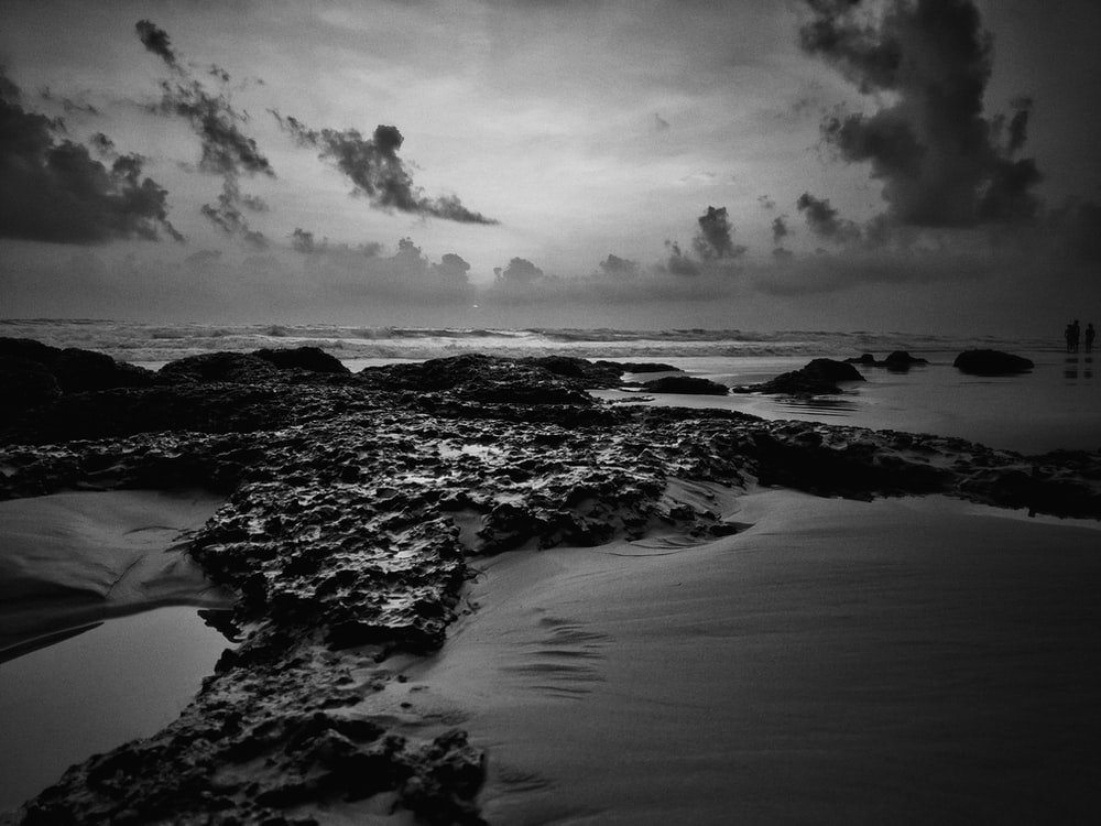 grayscale photography of stones and sand