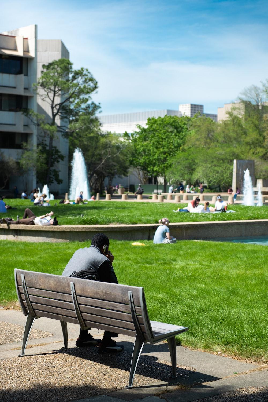 man sitting on bench during daytime