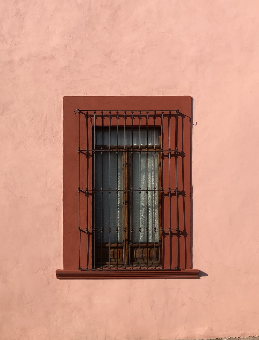 closed brown wooden window