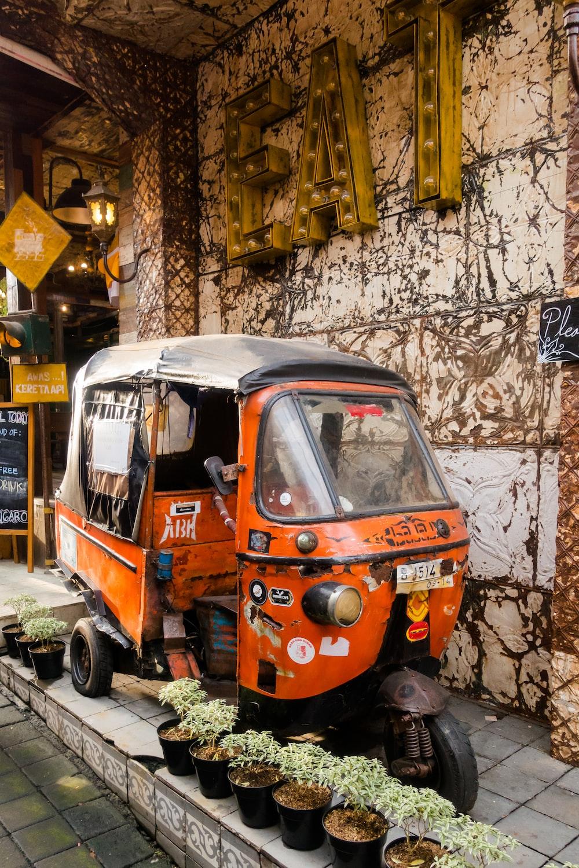 orange auto-rickshawl