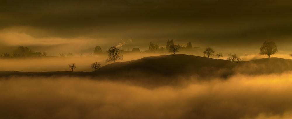black mountain surround in fogs