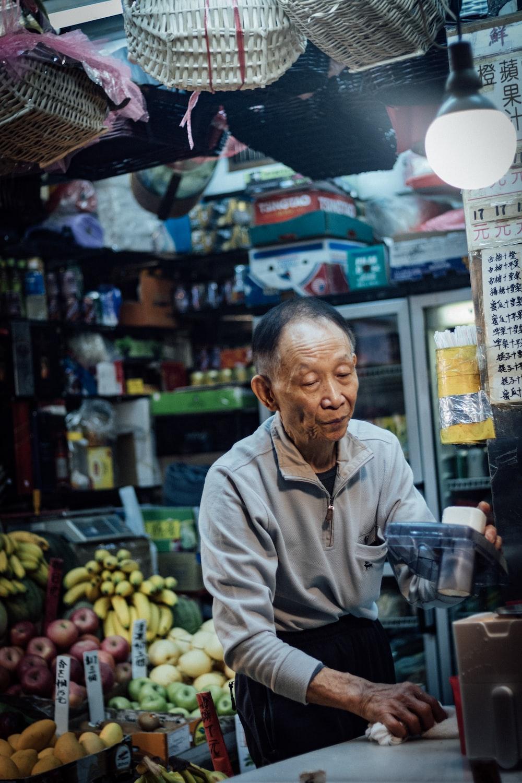 man standing inside fruit store