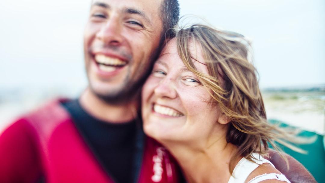 Smiling Woman and Man Hugging During Daytime - unsplash