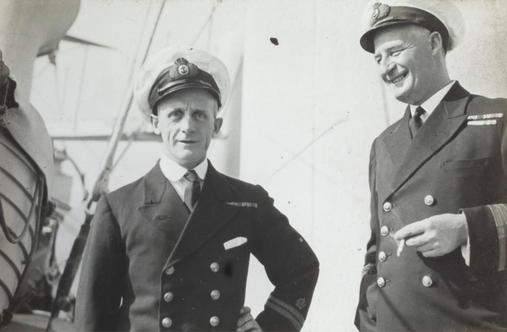 two man wearing uniform