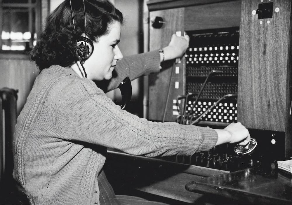 grayscale photo of woman using headphones