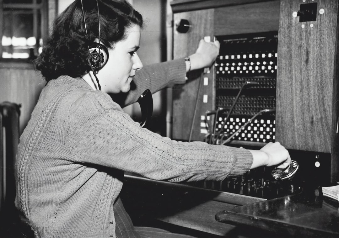 SUNSHINE PERSONALITIES - MISS JOAN HOWARD IS ONE OF THE YOUNG LADIES WHO ATTEND THE SWITCHBOARD AT HEAD OFFICE, SUNSHINE: `SUNSHINE REVIEW': SEPT 1949