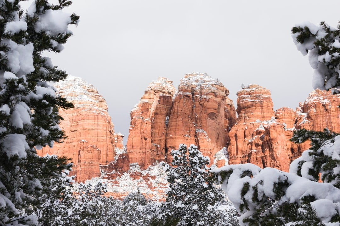 Beautiful Contrast Between Snow and Red Sedimentary Rock Formations.  - unsplash