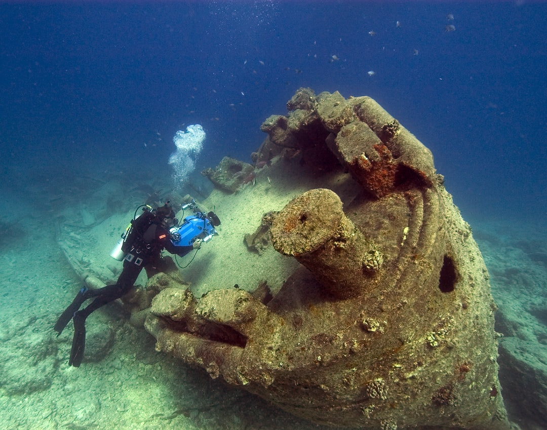 Noaa Diver John Brooks Inspecting the Remains of the Uss Macaw At Midway Island.  - unsplash
