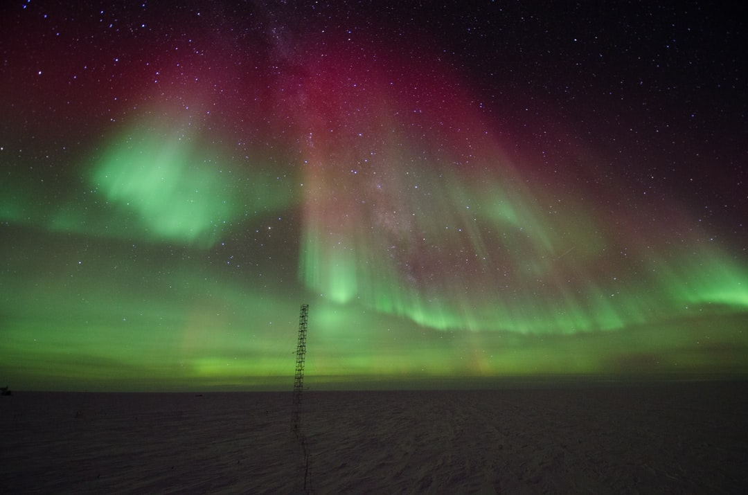 Aurora australis over the meteorological tower of the Atmospheric Research Observatory.
