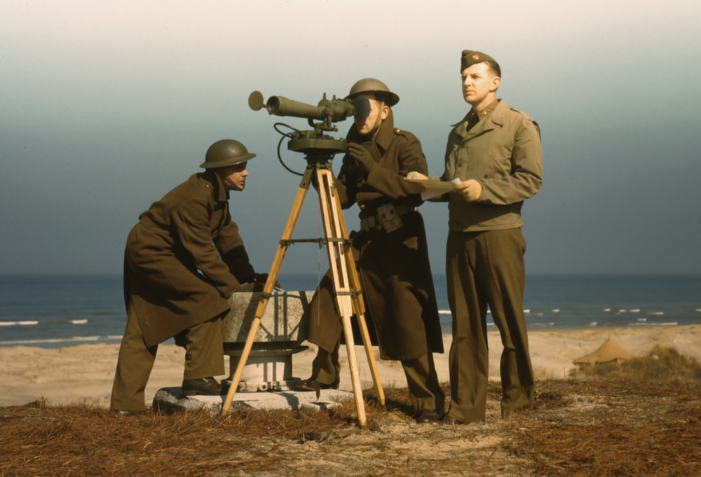 Men of Fort Story operate an azimuth instrument, to measure the angle of splash in sea-target practice, Fort Story, Va