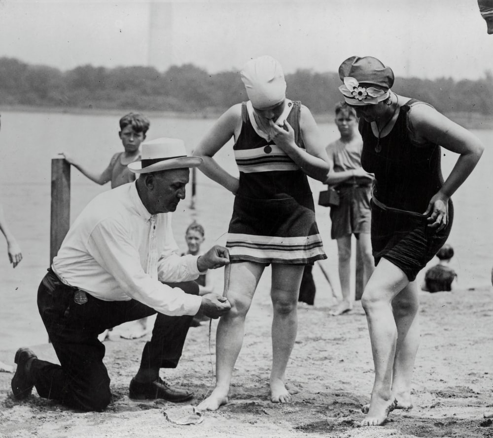 Col. Sherrell, Supt. of Public Buildings and Grounds measuring swimsuits