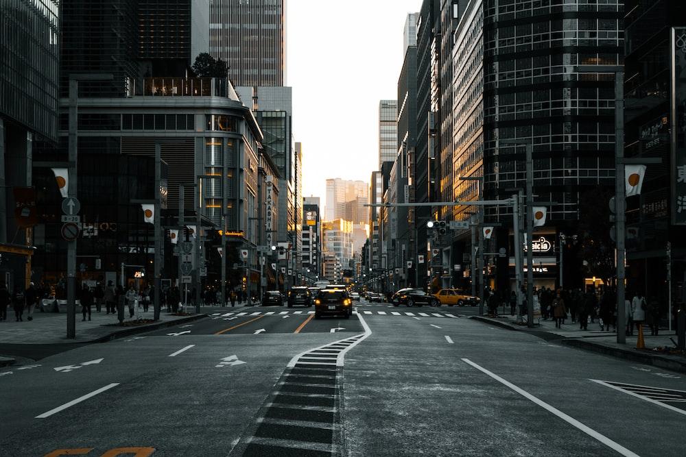 black vehicle on road between buildings during daytime