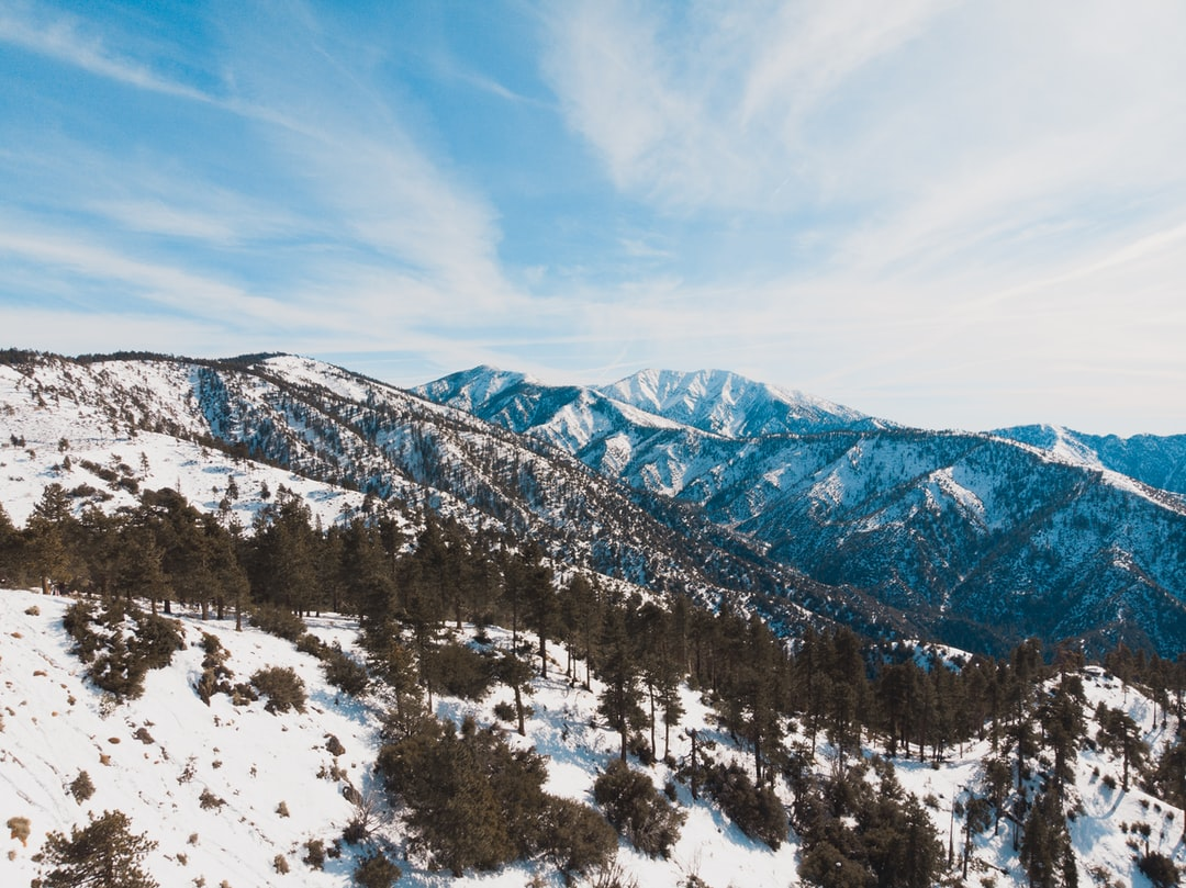 Drone's eye view of the snowy mountains