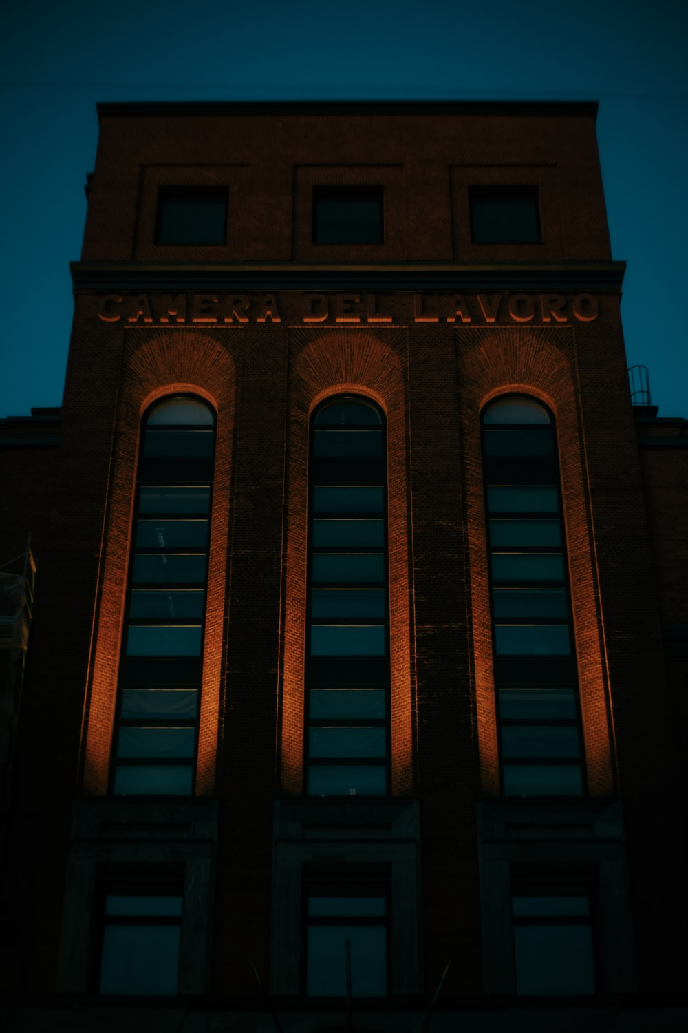 close-up photography of brown building during nighttime