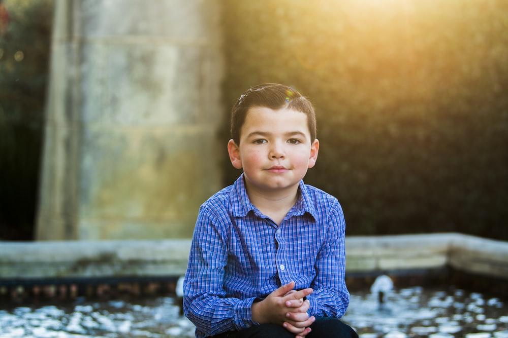 boy wearing blue dress shirt