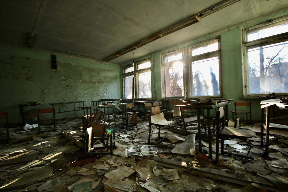 abandoned school with desk and chairs