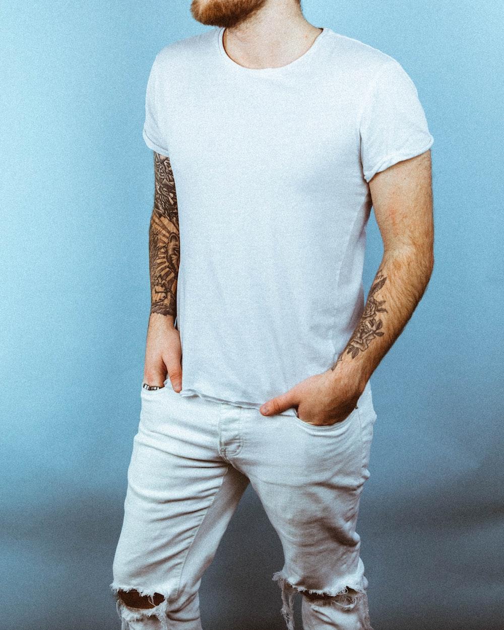 man wearing white crew-neck t-shirt