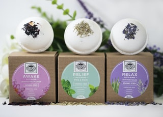 three assorted-label bath bombs with boxes