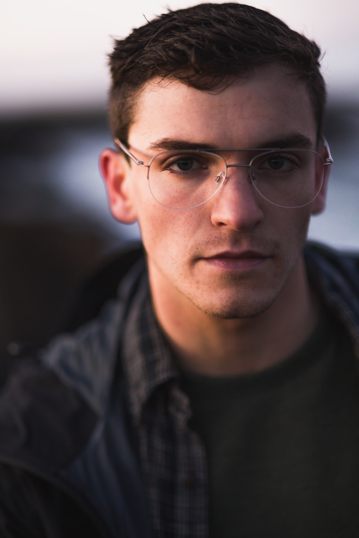 men's gray framed eyeglasses and black jacket