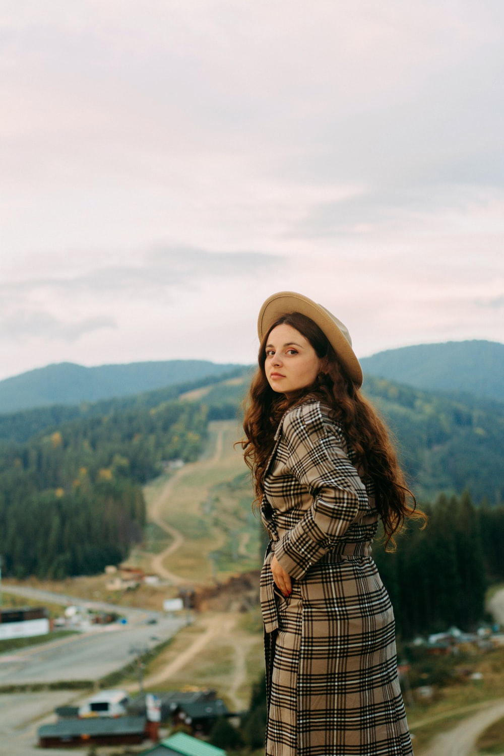 selective focus photography of woman in plaid coat