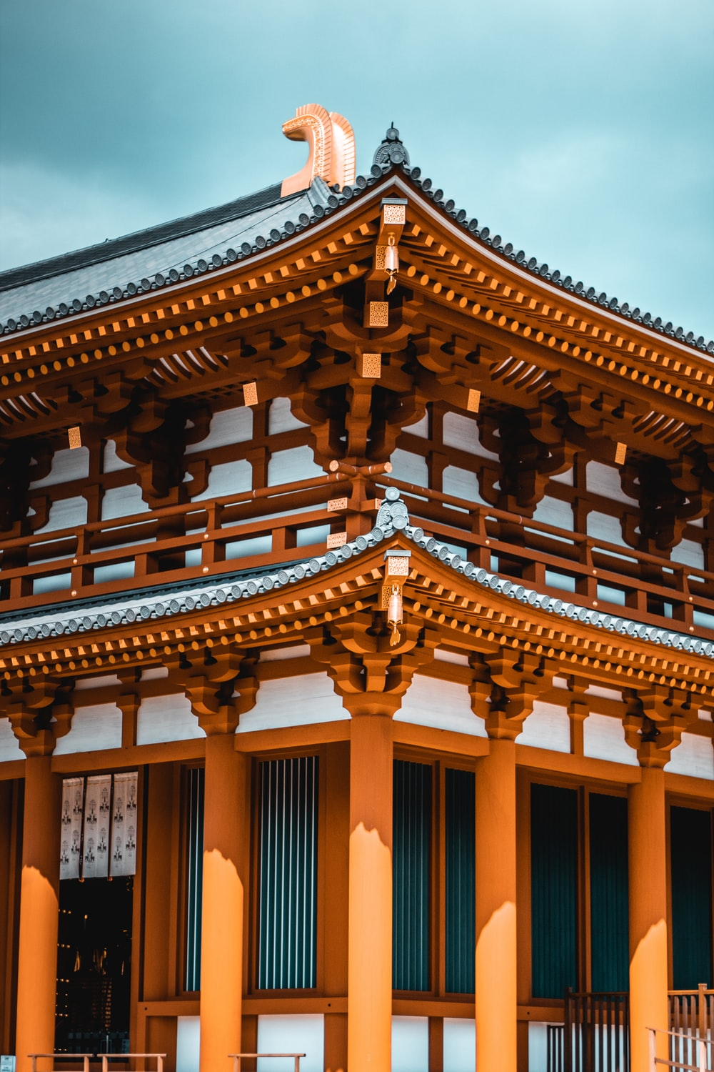 brown and white wooden temple during daytime