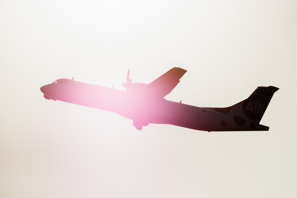silhouette of airplane during golden hour