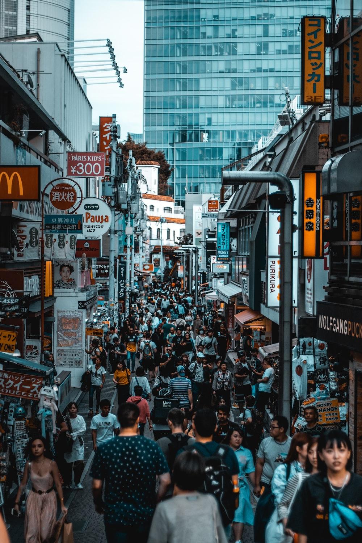 crowd walking on street during daytime