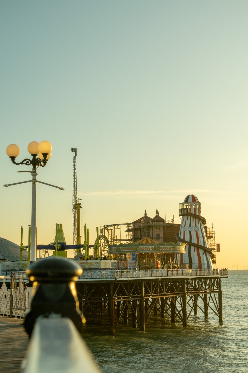 selective focus photography of theme park on shore during daytime