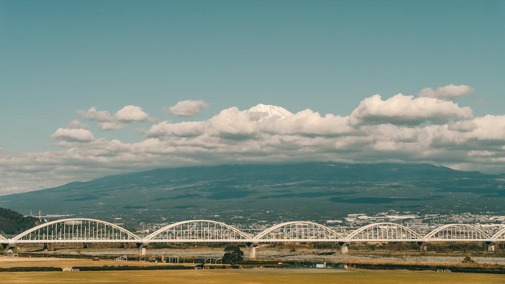 view of metal bridge near mountain at daytime