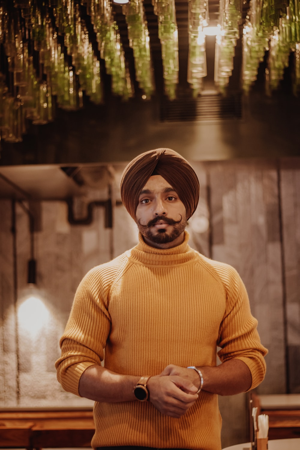 selective focus photography of standing man wearing turban