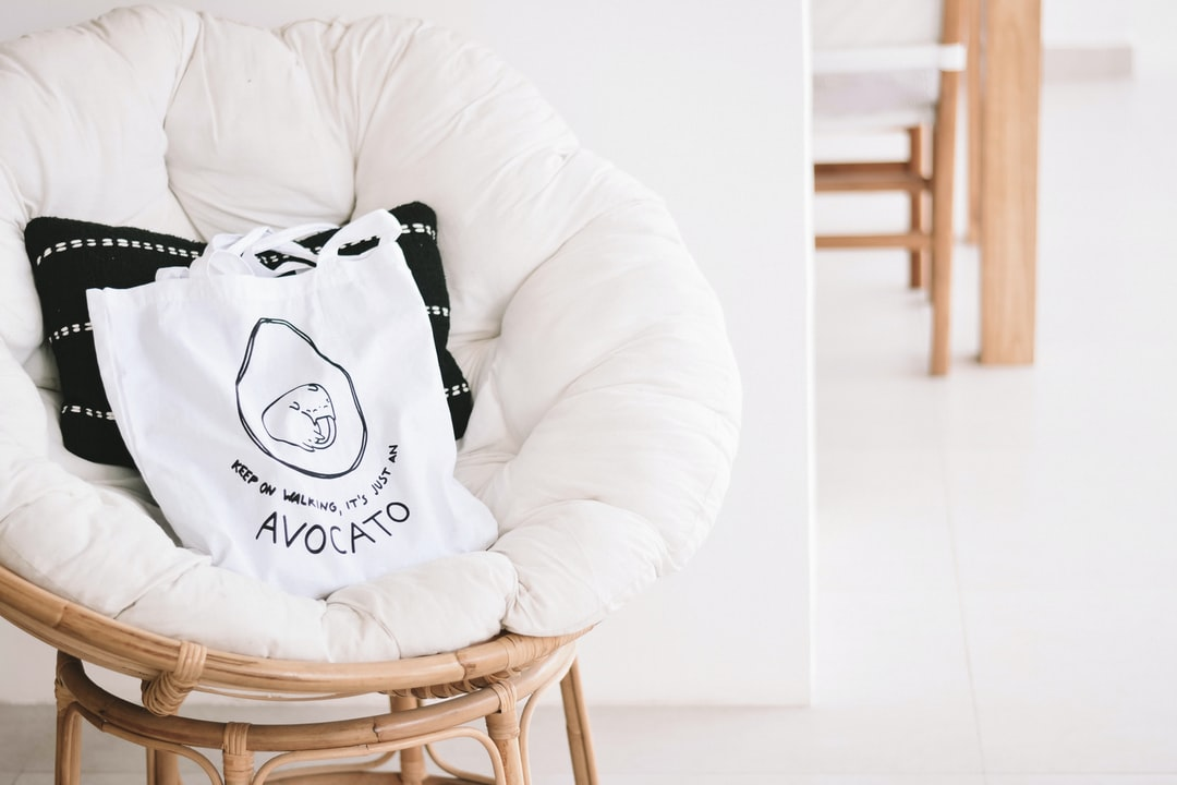 Tote Bag On A Bamboo Stool In the Light Interior - unsplash