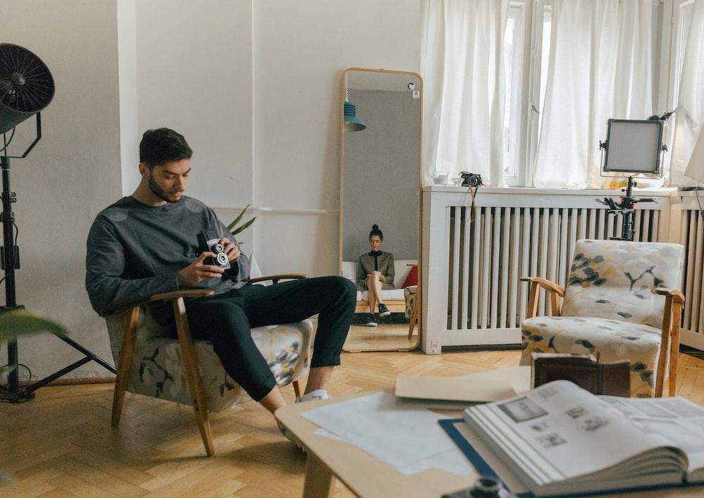 man sitting on the sofa chair