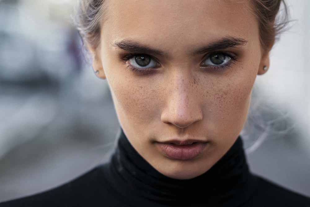 woman in black turtleneck top