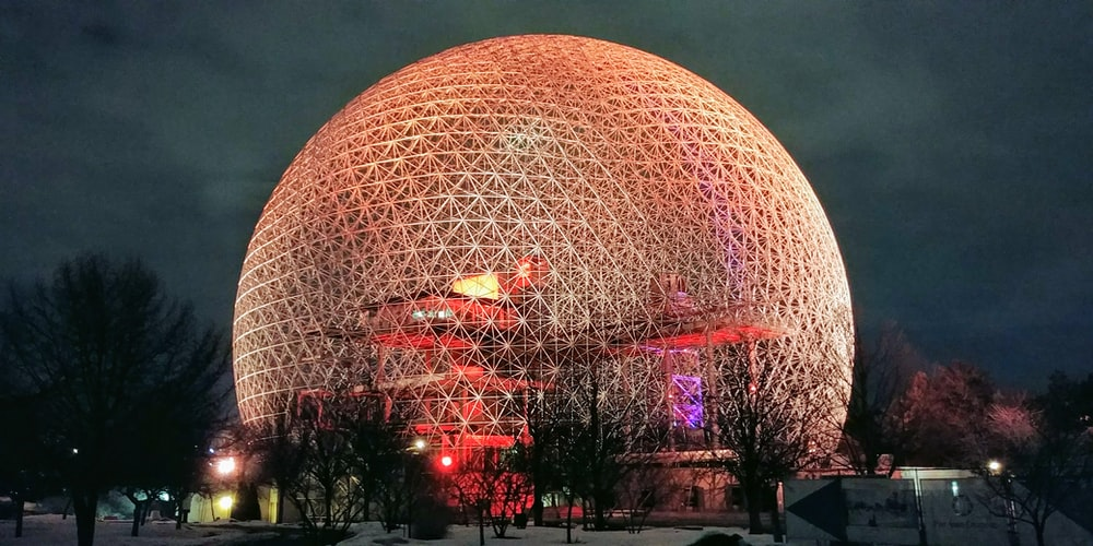 gold sphere landmark at night time