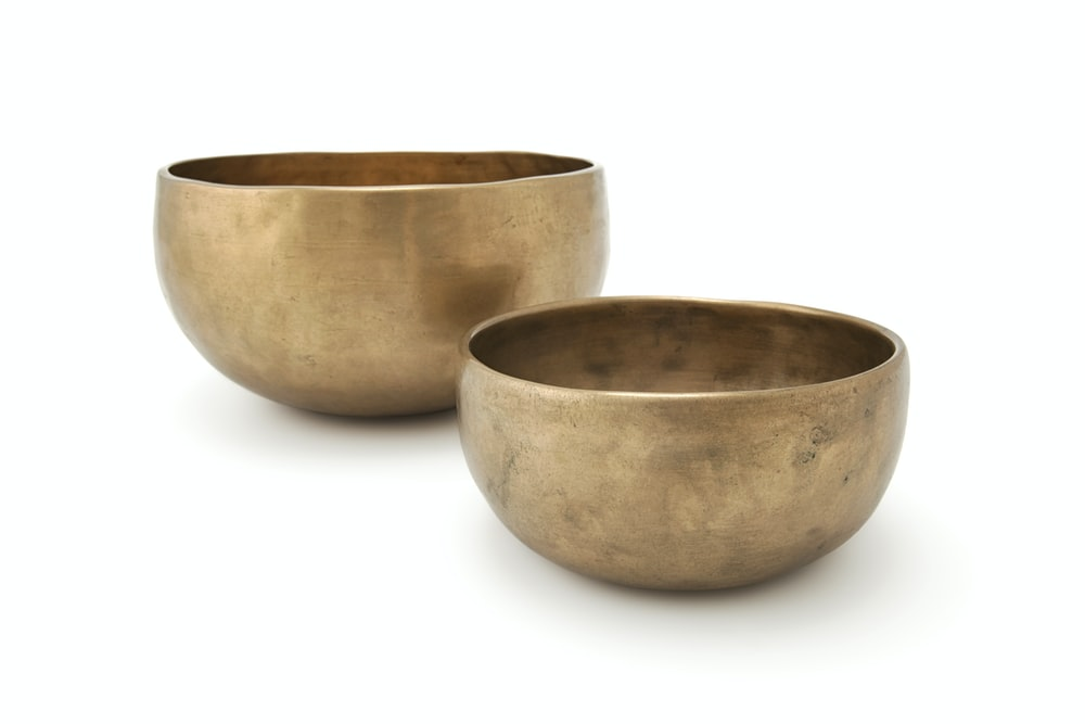two gold-colored bowls