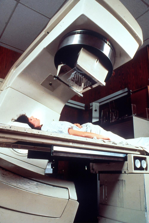 woman lying on machine bed