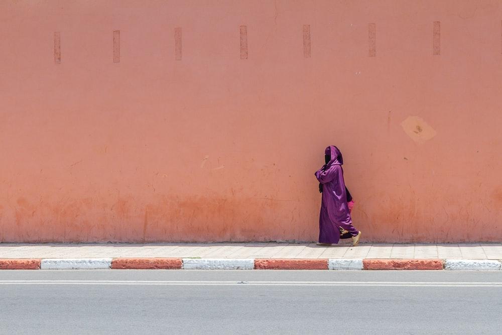 woman wearing purple silk abaya