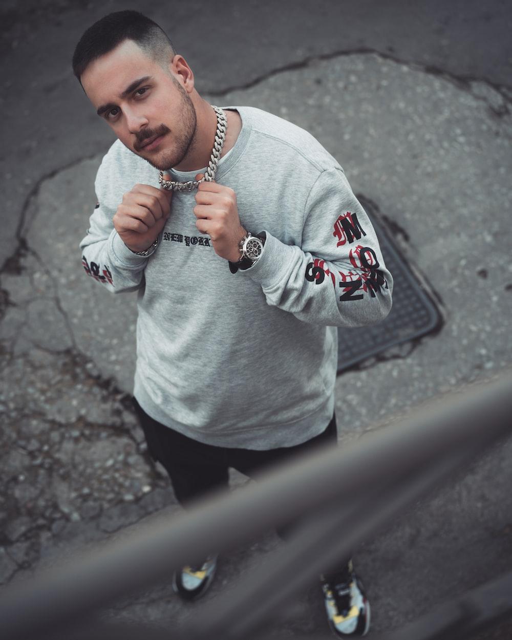 man wearing gray sweatshirt