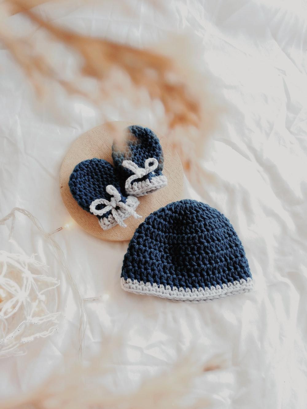 babys black knit cap and gloves