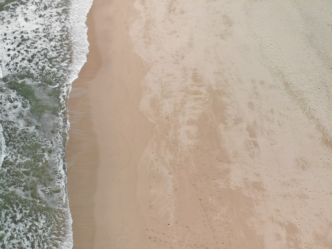 Waves and sand.