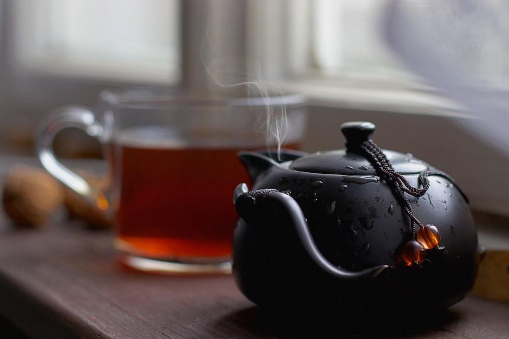black teapot near clear glass mug
