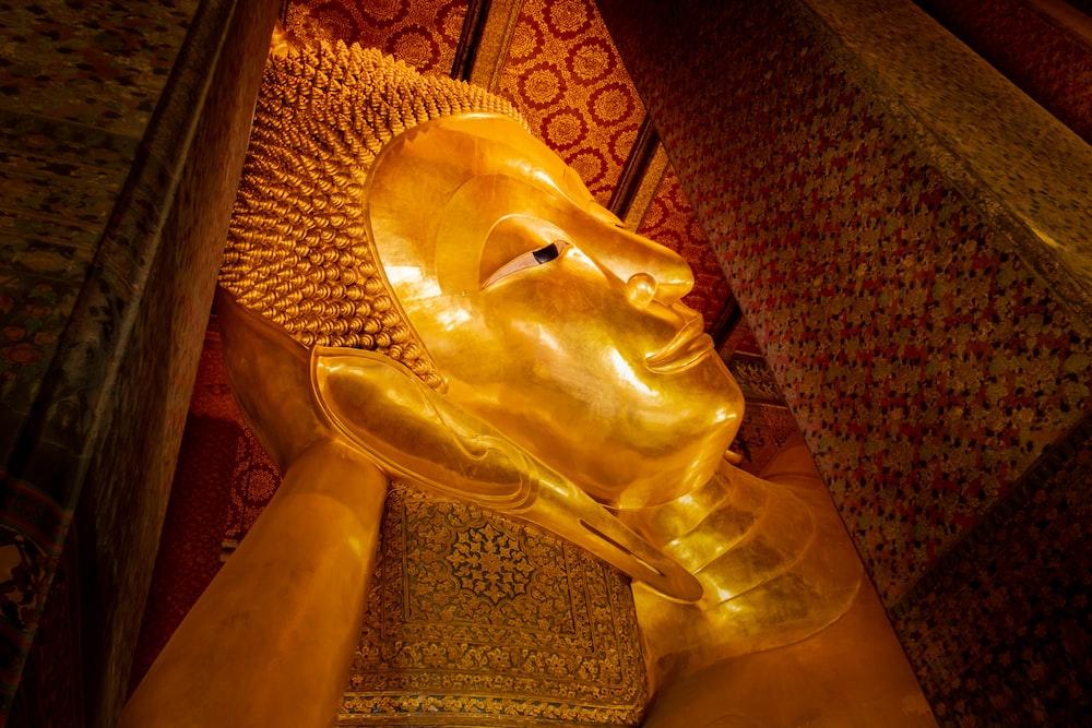 gold-colored buddha head