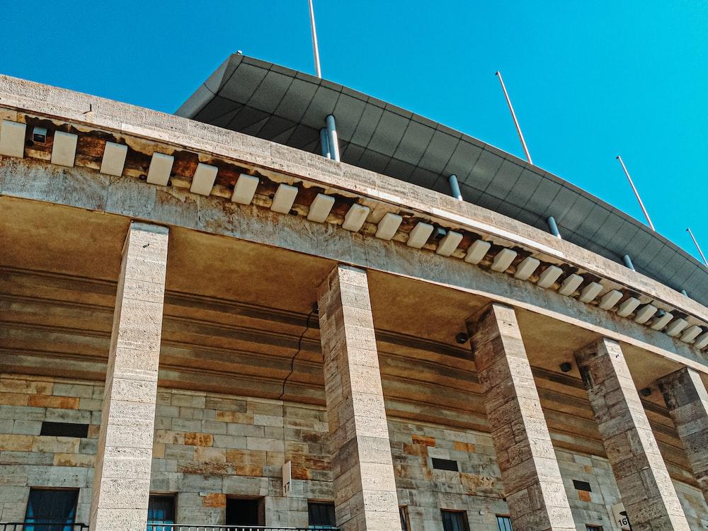bottom view of concrete building under blue sky