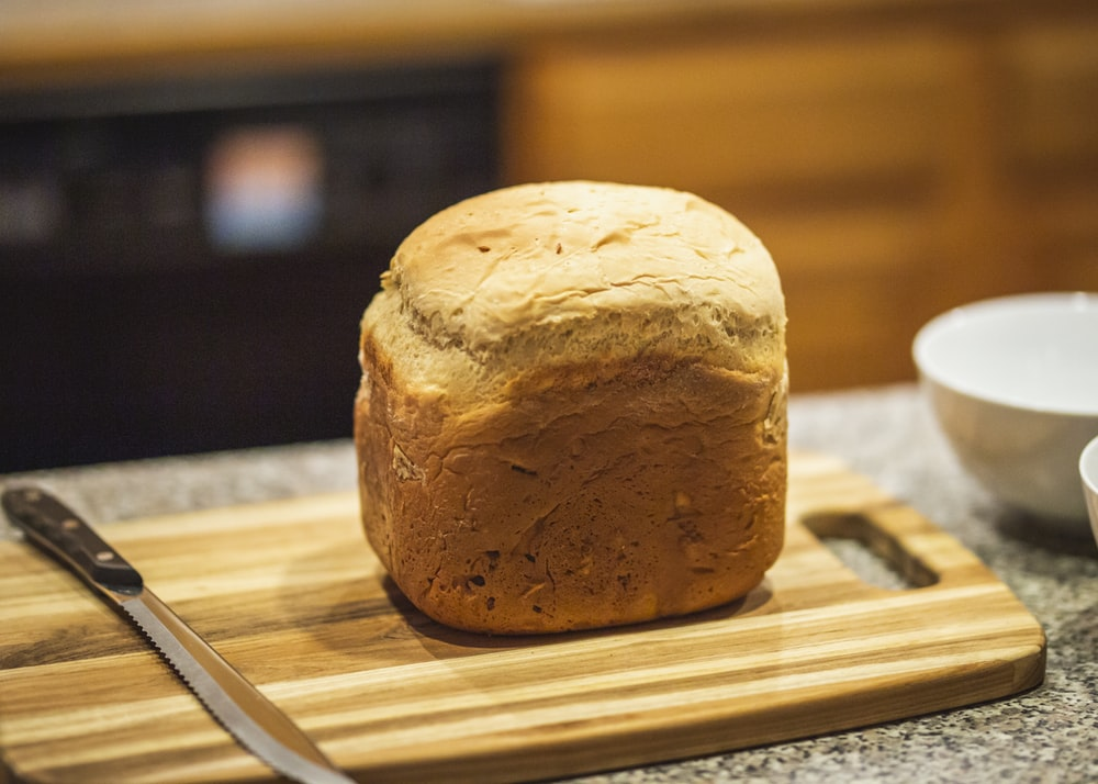 close up photography of bread on brown chopping board