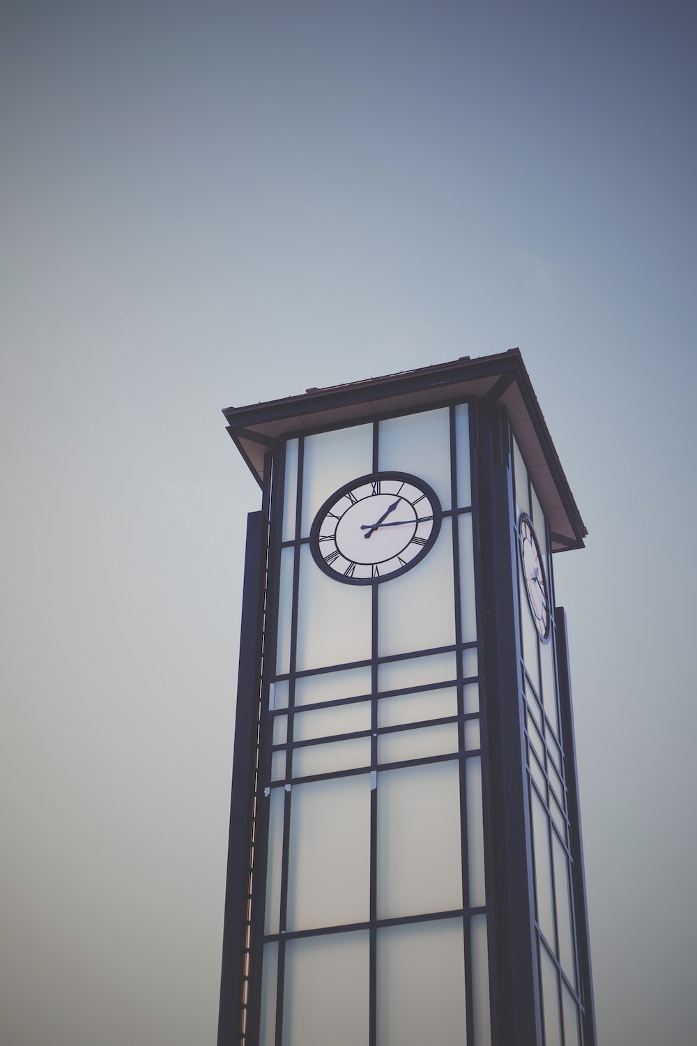 brown and white tower with clock