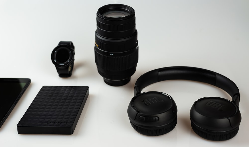 black cordless headphone near camera lens